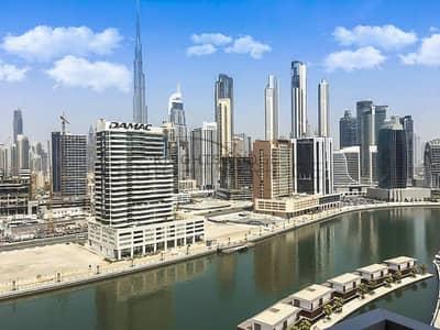 شقة 1 غرفة نوم للايجار في الخليج التجاري، دبي - Best Offer-Burj Khalifa/Canal View-1 B/R for rent
