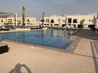 4 Bedroom Villa for Rent in Town Square, Dubai - Pool and park view 4 Bed Maid villa Single row Safi