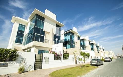 3 Bedroom Townhouse for Rent in Jumeirah Village Circle (JVC), Dubai - 3BR + Maid Triplex TH | Private Pool | Basement | Large Terrace