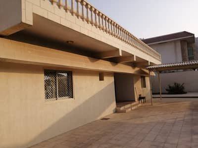 7 Bedroom Villa for Rent in Al Ghafia, Sharjah - 7 BHK S/S Villa with huge majlis, living dining, maid/driver room, 2 store, split A/C, lawn, parking,