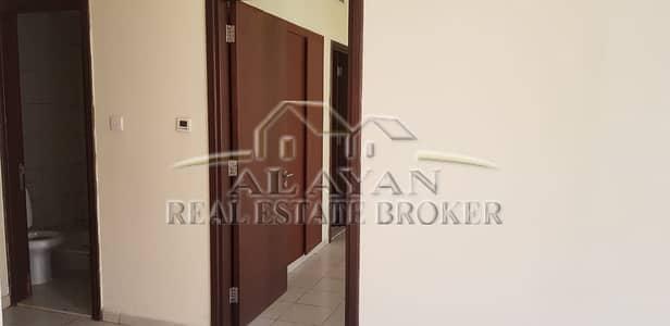 فلیٹ 1 غرفة نوم للايجار في المدينة العالمية، دبي - DOOR WITH WARDROBE VIEW