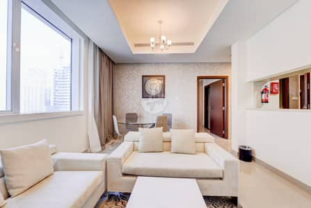 2 Bedroom Apartment for Rent in Dubai Marina, Dubai - a beautiful 2 bedroom hotel apartment in dubai marina in al dar tower with chiller and internet free
