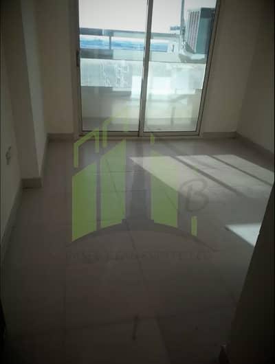 2 Bedroom Apartment for Rent in Emirates City, Ajman - Balcony door