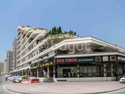 Shop for Rent in Al Qusais, Dubai - Building Image