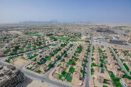 Plot for Sale in Jumeirah Village Triangle (JVT), Dubai - Corner G+1 |Second Row| Away from cables