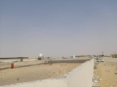Mixed Use Land for Rent in Al Saja, Sharjah - 20000 sqft open land with boundary wall, with SEWA connection, office, bathroom in Sajja area