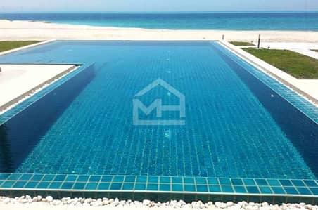 8 Bedroom Villa for Sale in Nurai Island, Abu Dhabi - Beachfront Luxurious 8BR Villa with Pool