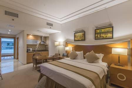 شقة فندقية  للايجار في برشا هايتس (تيكوم)، دبي - شقة فندقية في جراند بل فيو برشا هايتس (تيكوم) 63000 درهم - 4340376