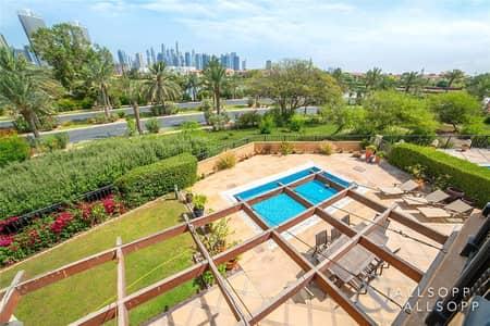 5 Bedroom Villa for Sale in Jumeirah Islands, Dubai - Upgraded | Large Plot | City Skyline View