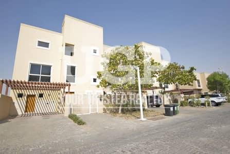 4 Bedroom Villa for Sale in Al Raha Gardens, Abu Dhabi - Luxurious 4BR Villa w/ Balcony and Parking!