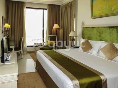 شقة فندقية 2 غرفة نوم للايجار في شارع الشيخ زايد، دبي - 2 BR Hotel Apartment City View with complimentary DEWA