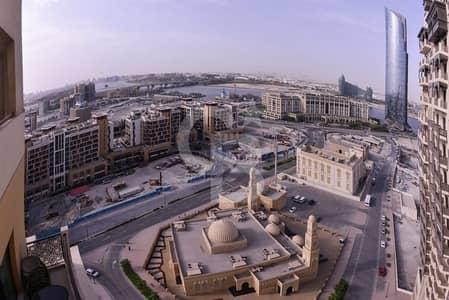 محل تجاري  للايجار في قرية التراث، دبي - Shop in Riah Towers   Shell and Core