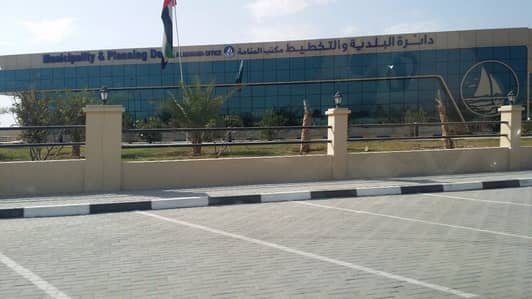 Plot for Sale in Al Manama, Ajman - own commercial land on main road only 240k 1 year instalment