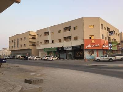 مبنى سكني 11 غرفة نوم للبيع في الروضة، عجمان - للبيع بناية في الروضه على شارعين