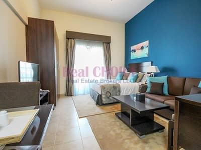 استوديو  للايجار في مثلث قرية الجميرا (JVT)، دبي - Affordable Furnished Studio|1 Month Free Rent