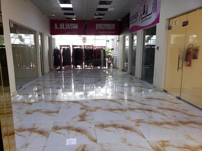 محل تجاري  للايجار في الروضة، عجمان - محلات تجارية للايجار شارع الشيخ عمار