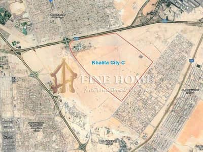 Plot for Sale in Zayed City (Khalifa City C), Abu Dhabi - Perfect commercial land in madinat Zayed