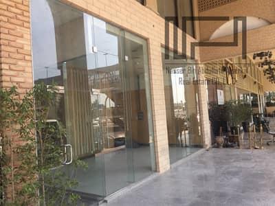 محل تجاري  للايجار في القرهود، دبي - Retail Shop on Main Road