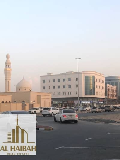 Building for Sale in Al Mowaihat, Ajman - For sale commercial building ground + 3 corner on Sheikh Ammar Street