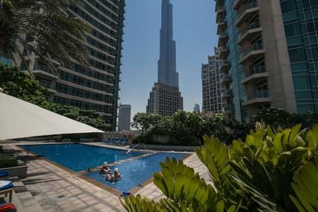 فلیٹ 2 غرفة نوم للايجار في وسط مدينة دبي، دبي - شقة في ذا لوفتس شرق ذا لوفتس وسط مدينة دبي 2 غرف 119999 درهم - 4388559