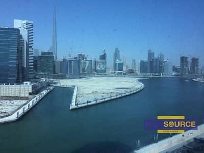 مکتب  للايجار في الخليج التجاري، دبي - Furnished Office-Full Burj khalifa and Canal View in Business Bay.