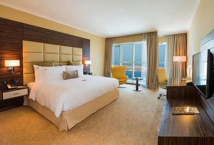 شقة فندقية  للايجار في منطقة النادي السياحي، أبوظبي - شقة فندقية في فندق جنة ابراج السراب شارع المينا منطقة النادي السياحي 65000 درهم - 4397427