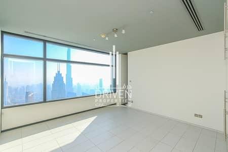 فلیٹ 3 غرف نوم للبيع في مركز دبي المالي العالمي، دبي - Rare Corner Unit with Burj and Sea Views