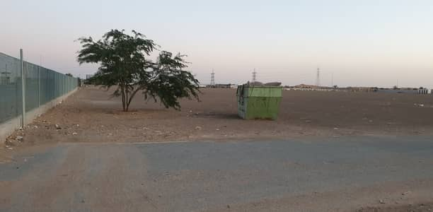 Industrial Land for Rent in Emirates Modern Industrial Area, Umm Al Quwain - 600,000 square feet Open land with concrete flooring available in Emirates Modern Industrial Area, Umm Al Quwain