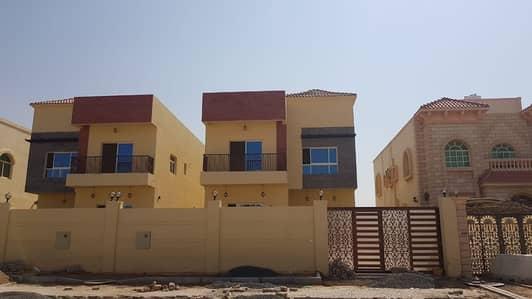 فیلا 5 غرفة نوم للبيع في الروضة، عجمان - فيلا جديده 5 غرف بموقع ممتاز وتشطيبت متميزه بواجهه حجر علي الشارع الجار