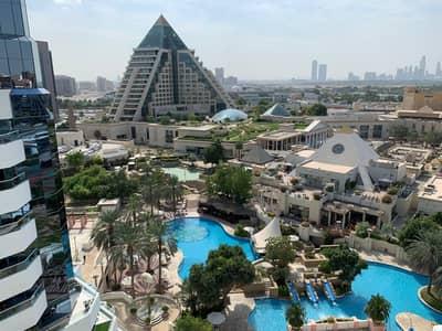 2 Bedroom Flat for Rent in Bur Dubai, Dubai - Luxury Living / 2 Bed Un-Fur Apt / Pool & Garden View Save