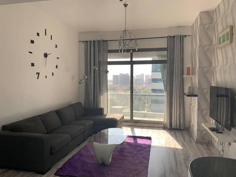 شقة في برج حمزة مدينة دبي الرياضية 2 غرف 750000 درهم - 4402409