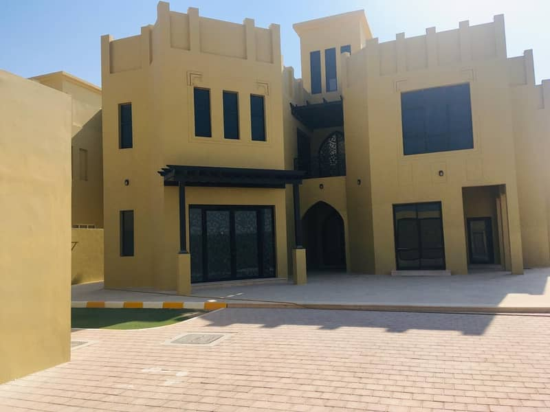 EUROPEAN STYLE 4 BEDROOM VILLA WITH POOL BIG FRONT YARD AND C. PARKING IN KHALIFA CITY B.