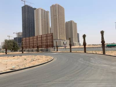 Plot for Sale in Al Aaliah, Ajman - Commercial residential land Tower permit premiums
