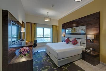 شقة فندقية 2 غرفة نوم للايجار في مدينة دبي الرياضية، دبي - Bedroom 1
