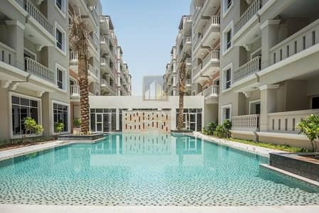 2 Bedroom Apartment for Rent in Dubai Investment Park (DIP), Dubai - 1 Month Free Modern 2BR with Pool and Garden View