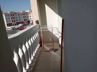 1 Bedroom Apartment for Sale in International City, Dubai - Spacious  Rented 1-Bedroom Apartment with 2 balcony in England Cluster