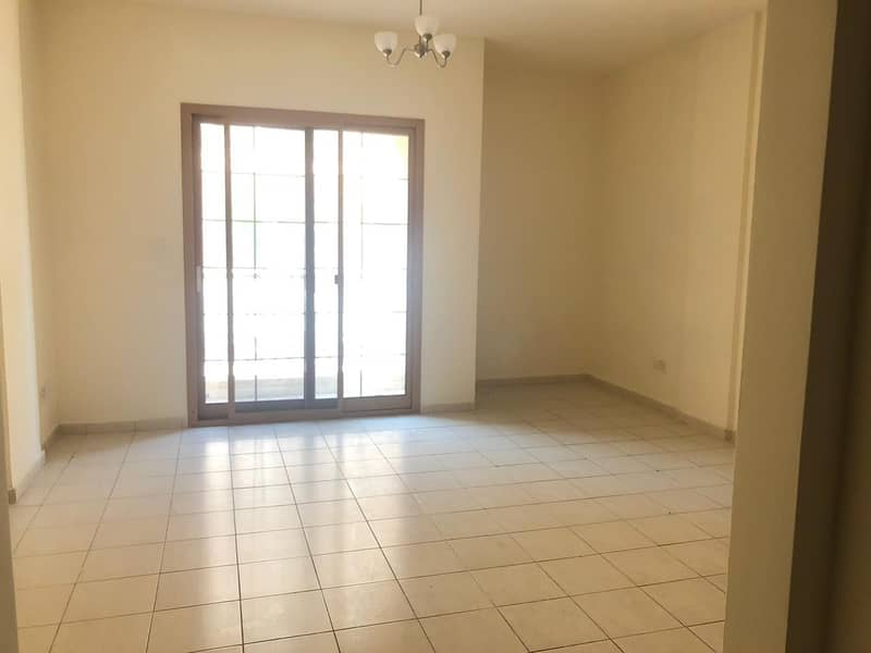 Studio flat in international city England cluster for sale AED 249k