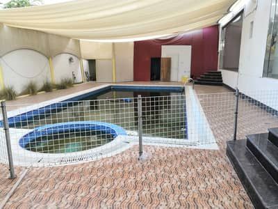5 Bedroom Villa for Sale in Al Rawda, Ajman - 10,000 ft ground floor villa with swimming pool and outdoor supplements at an excellent price