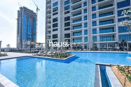 فلیٹ 2 غرفة نوم للبيع في التلال، دبي - Exclusive | High Floor | 2 Bed + 2 Bath