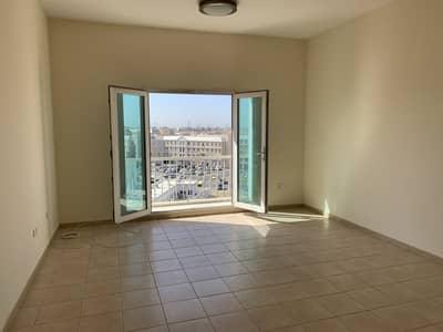 شقة 1 غرفة نوم للايجار في المدينة العالمية، دبي - غرفه نوم واحده للإيجار في CBD مع شرفه   شهر واحد مجانا
