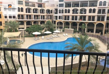 Studio for Rent in Jumeirah Village Circle (JVC), Dubai - POOL FACING VIEW / WIDE OPEN STUDIO LAYOUT