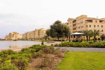 2 Bedroom Flat for Rent in Yasmin Village, Ras Al Khaimah - Marvellous 2 BHK apartment with balcony for rent in Yasmin Village