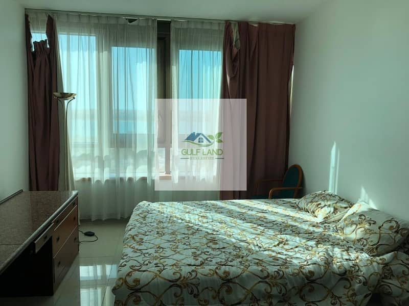 studio with furniture include electric and water sea view