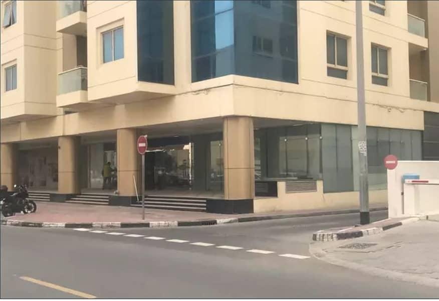 محل تجاري في بناية الحباي الكرامة 272000 درهم - 4441271