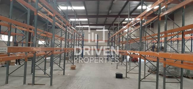Warehouse for Sale in Al Quoz, Dubai - Affordable-priced Semi- fitted Warehouse