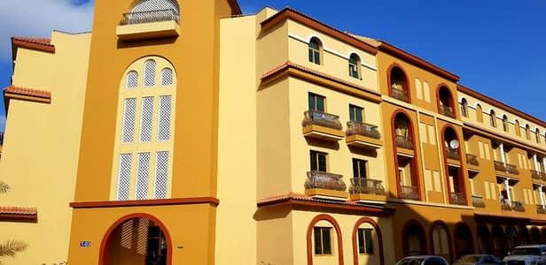 فلیٹ 1 غرفة نوم للايجار في المدينة العالمية، دبي - INTERNATIONAL CITY LARGE غرفة نوم واحدة متوفرة في اسبانيا الفئة مع الشاحن فقط 32000