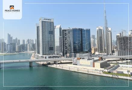 شقة 2 غرفة نوم للايجار في الخليج التجاري، دبي - شقة في برج ارت XV الخليج التجاري 2 غرف 87000 درهم - 4455146