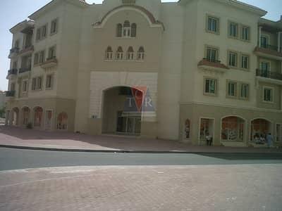 محل تجاري  للايجار في المدينة العالمية، دبي - Roundabout Fitted Ready shop for rent in Greece cluster