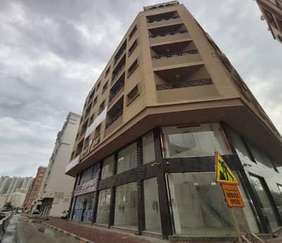 مبنی تجاري  للبيع في الراشدية، عجمان - من المالك مباشرةً » بناية جديدة سكنى تجارى للبيع بمنطقة الراشدية
