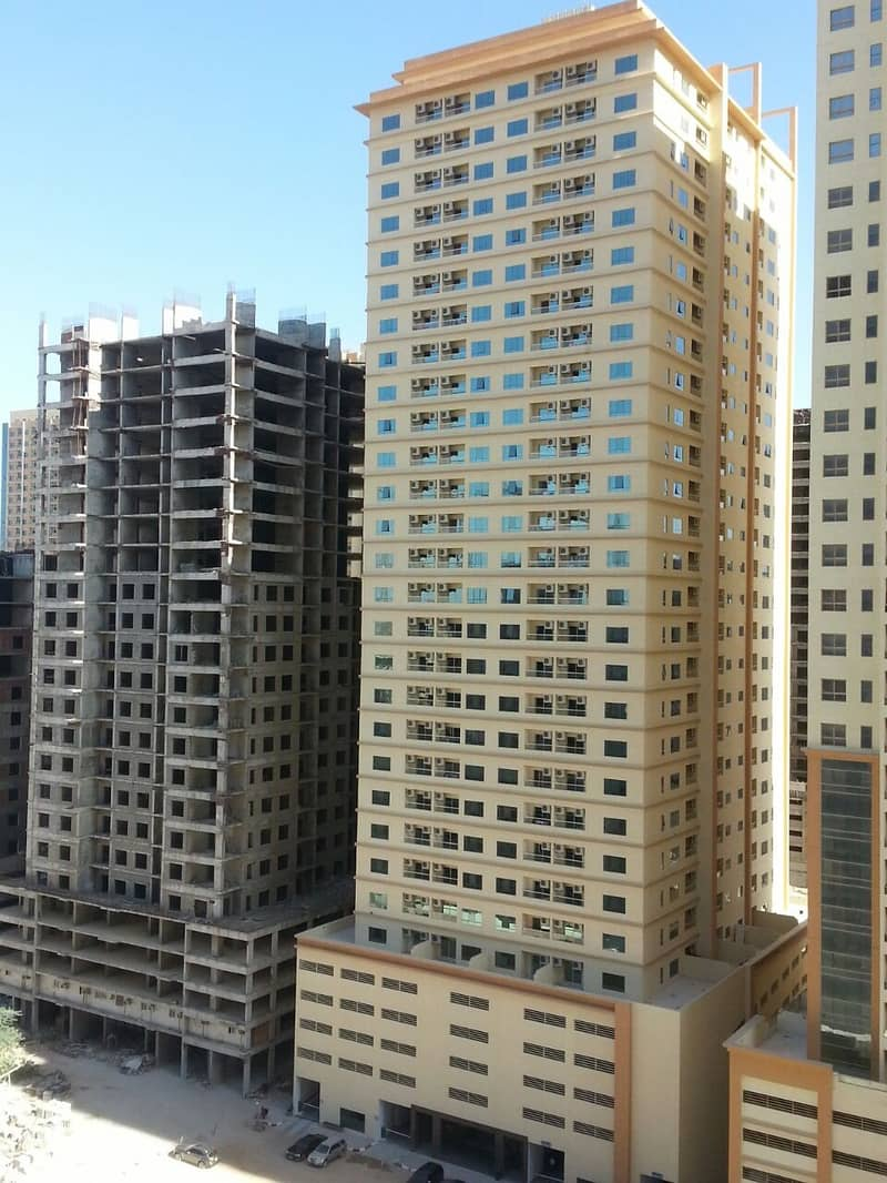 HOT OFFER. . . SPEACIOUS TWO BEDROOM HALL WITH PARKING FEWA PAID IN LAKE TOWER C4 AJMAN